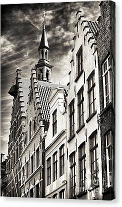 Dark Sky In Bruges Canvas Print by John Rizzuto
