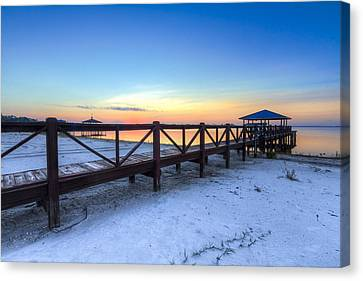 Dawn At The Dock Canvas Print by Debra and Dave Vanderlaan