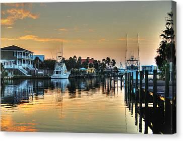 Canvas Print featuring the photograph Dawn On A Orange Beach Canal by Michael Thomas