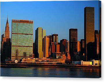 Dawn On Manhattan Canvas Print by James Kirkikis