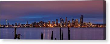Dawn Panorama Of Downtown Seattle From Alki Beach Canvas Print by Silvio Ligutti