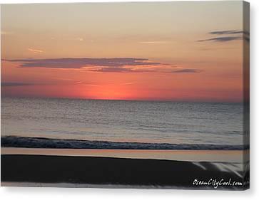 Dawn's Spreading Light Canvas Print by Robert Banach