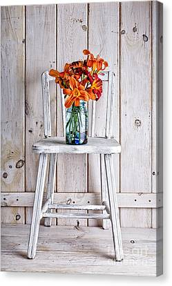 Day Lilly Canvas Print - Daylillies On A White Chair by Edward Fielding