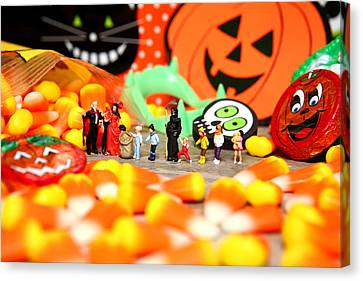 Death Takes His Kids Trick Or Treating Canvas Print by Lon Casler Bixby