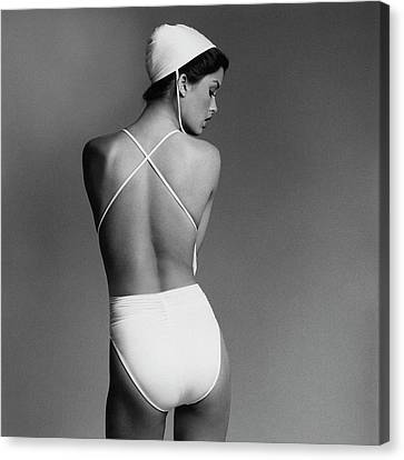 Debbie Dickinson Wearing A Kamali Bathing Suit Canvas Print by Francesco Scavullo