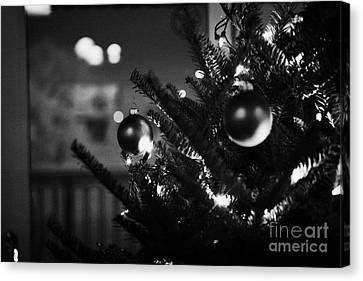 decorated christmas tree looking out of window to snow covered scene in small rural village of Forge Canvas Print by Joe Fox