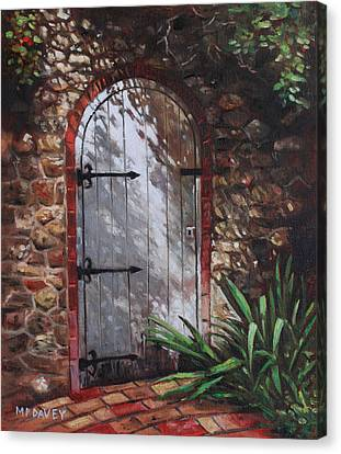 Decorative Door In Archway Set In Stone Wall Surrounded By Plants Canvas Print
