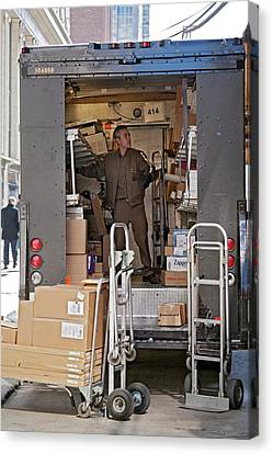 Deliver Driver Loading His Van Canvas Print by Jim West