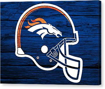 Old Barns Canvas Print - Denver Broncos Football Helmet On Worn Wood by Dan Sproul