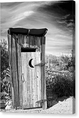 Desert Outhouse Under Stormy Skies Canvas Print