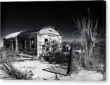 Deserted In The Desert  Canvas Print by John Rizzuto