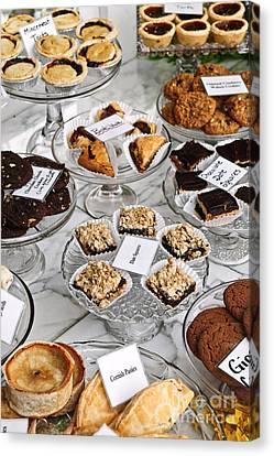 Desserts In Bakery Window Canvas Print by Elena Elisseeva