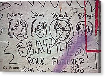 Detail Of Graffiti On Abbey Road Sign Canvas Print by George Pedro