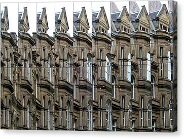 Detailed Window Reflections At The Bourse. Boar Lane. Leeds Uk. Canvas Print by Rob Huntley