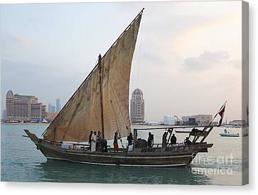 Dhow And Hotels Canvas Print by Paul Cowan