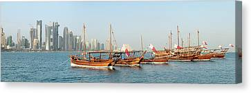Dhows On Parade In Doha Canvas Print by Paul Cowan