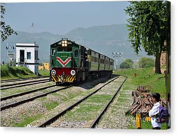 Canvas Print featuring the photograph Diesel Electric Locomotive Speeds Past Student by Imran Ahmed