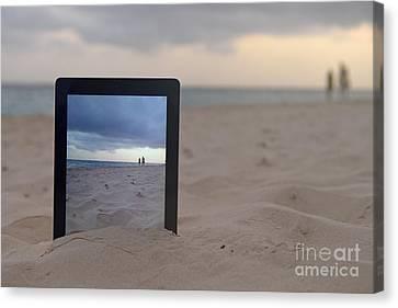 Digital Tablet In Sand On Beach Canvas Print by Sami Sarkis