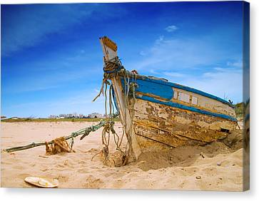 Dilapidated Boat At Ferragudo Beach Algarve Portugal Canvas Print by Amanda Elwell