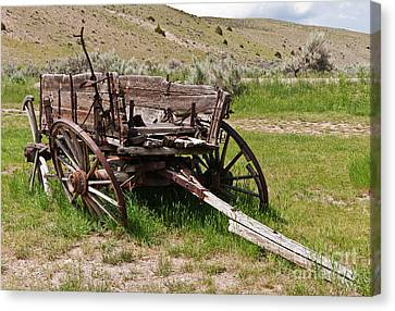 Dilapidated Wagon With Leaning Wheels Canvas Print by Sue Smith