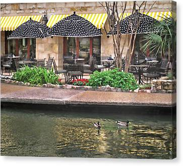 Dining On The Riverwalk Canvas Print by David and Carol Kelly