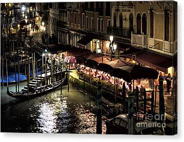 Dinner On The Grand Canal At Night Canvas Print by John Rizzuto