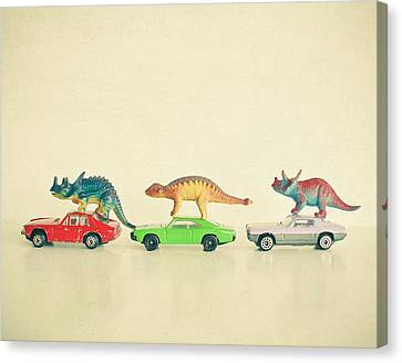 Dinosaurs Ride Cars Canvas Print by Cassia Beck