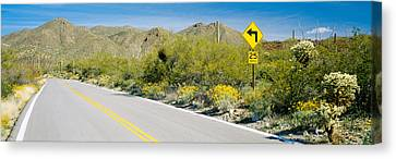 Directional Signboard At The Roadside Canvas Print by Panoramic Images