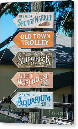 Distressed Key West Sign Post Canvas Print by Ian Monk