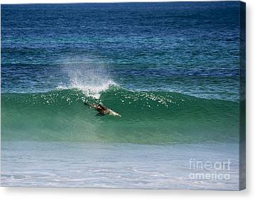 Diving Beneath The Curl Canvas Print by Mike Dawson