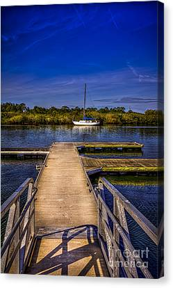 Dock And Boat Canvas Print by Marvin Spates