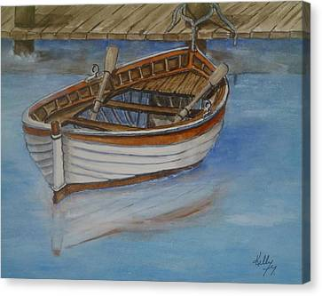Docked Rowboat Canvas Print by Kelly Mills