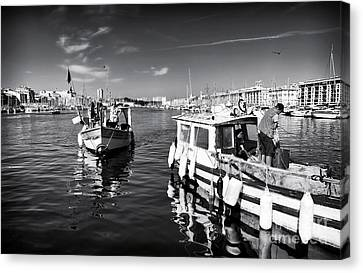 Docking At The Market Canvas Print by John Rizzuto
