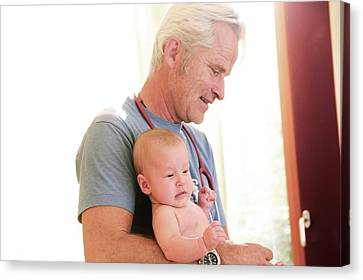Bonding Canvas Print - Doctor Holding Baby by Gombert, Sigrid