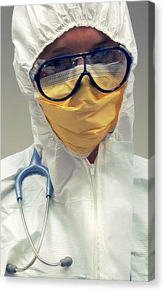 Doctor In Biohazard Suit Canvas Print by Public Health England