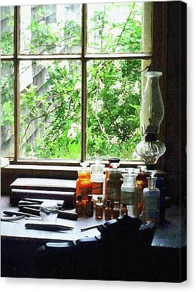 Canvas Print featuring the photograph Doctor - Medicine And Hurricane Lamp by Susan Savad