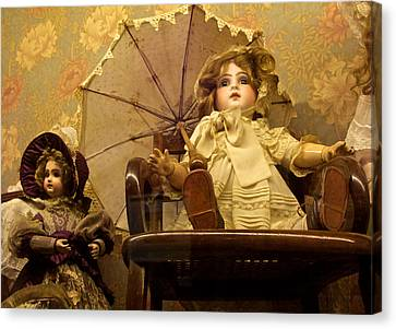 Antique Doll In Chair With Parasol Canvas Print