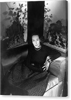 Dolores Del Rio Sitting In An Armchair Canvas Print by Horst P. Horst