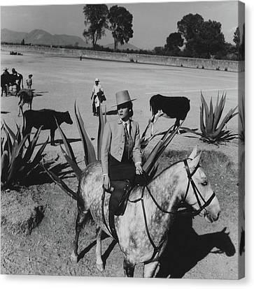 Dolores L. Corcuera Riding Side-saddle Canvas Print by Horst P. Horst
