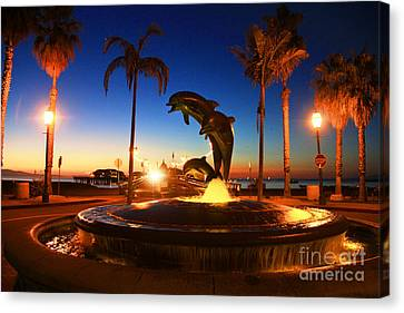 Dolphins At Dawn Canvas Print by Dave Donaldson