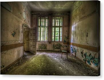 Door On To Chair Canvas Print by Nathan Wright