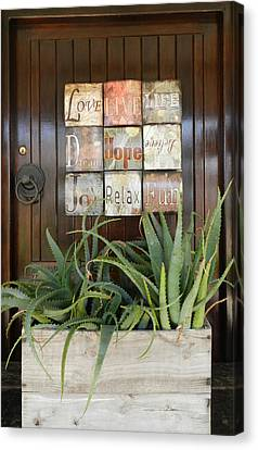 Door With A Message Canvas Print by Leana De Villiers