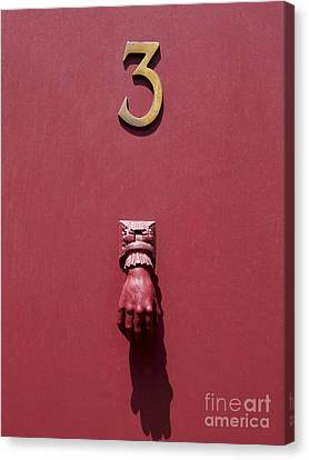 Doorknocker And Number Three On A Red Door. France. Europe. Canvas Print by Bernard Jaubert