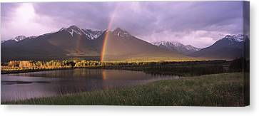 Double Rainbow Over Mountain Range Canvas Print by Panoramic Images