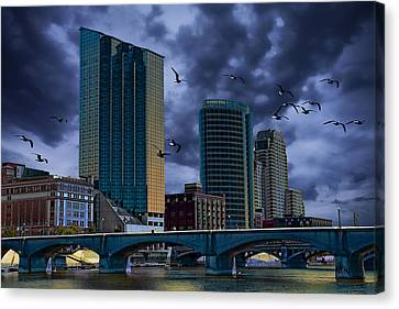 Flying Gull Canvas Print - Downtown Grand Rapids Michigan By The Grand River With Gulls by Randall Nyhof