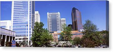 Downtown Modern Buildings In A City Canvas Print by Panoramic Images