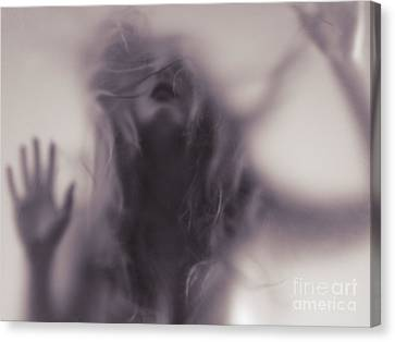 Dramatic Photo Of Woman Blurred Silhouette Behind Hazy Glass Canvas Print