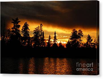Dramatic Sunset Canvas Print by Larry Ricker