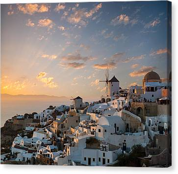 Dramatic Sunset Over The Windmills Of Oia Village In Santorini Canvas Print by Gurgen Bakhshetsyan