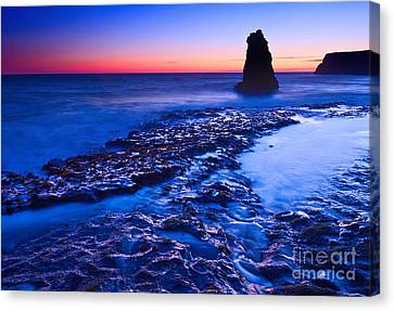 Dramatic Sunset View Of A Sea Stack In Davenport Beach Santa Cruz. Canvas Print by Jamie Pham
